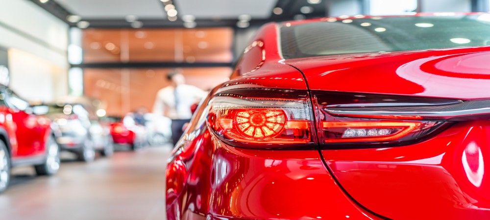 rear view of new modern red car led tail lights in showroom